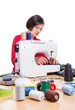 Girl at the sewing machine sews. Sewing Accessories.