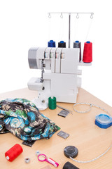 Overlock sewing machine on the table. Sewing Accessories.