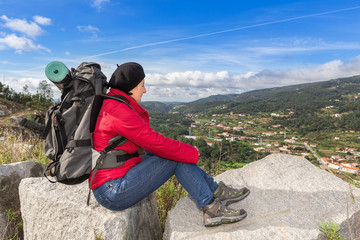 Woman traveler with a backpack resting.