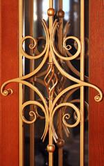 Forging detail over the door