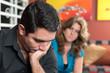 Divorce - Sad hispanic husband and his worried wife
