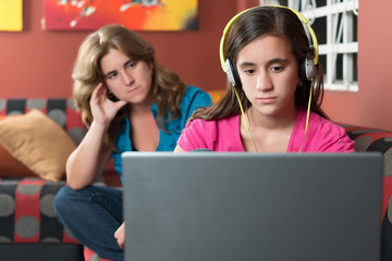 Internet addicted girl ignores her worried mother