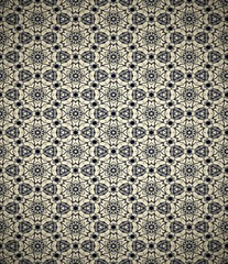 Dark retro wallpaper with flower and star pattern.