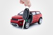 Hand holding keys to new car. Buy or selling business compositio - 76338697
