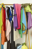Untidy messy cluttered woman wardrobe with colorful clothes. poster