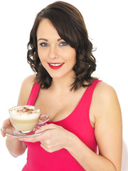 Young Woman Holding a Cup of Cappuccino Coffee