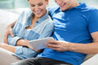 Smiling couple with tablet