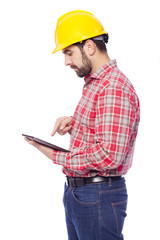 Young architect holding a tablet computer, isolated on white bac