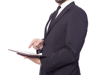 Business man using a tablet computer, isolated on a white backgr