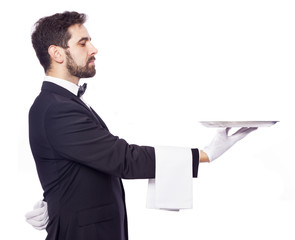 Waiter holding an empty silver tray over white background