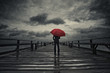 Red umbrella in storm - 76339850