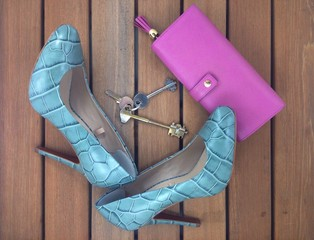 blue high heels and pink wallet