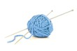 Ball of blue yarn with knitting needles isolated on white - 76340057