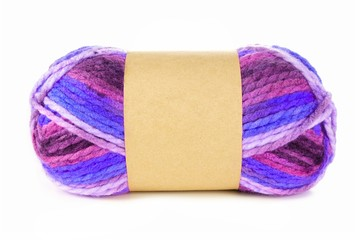 Multicolored knitting yarn with blank paper label isolated