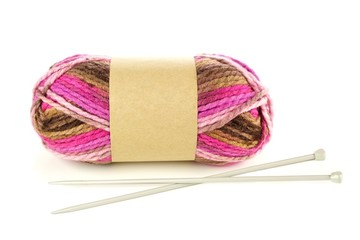 Multicolored yarn with blank paper label and knitting needles