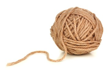 Ball of beige colored yarn isolated on white