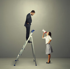 man standing on stepladder and looking