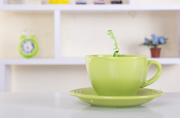 Splash of Green tea on a cup
