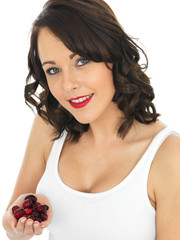 Young Woman Holding a Handful of Cranberries