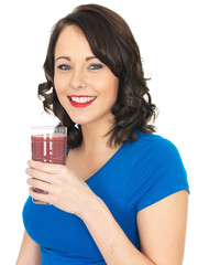 Healthy Young Woman Drinking a Smoothie