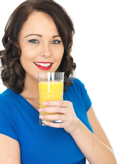 Healthy Young Woman Drinking Orange Juice