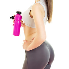 Rear view of fit young woman with water bottle