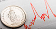 One Swiss Franc coin on fluctuating graph. Rate of the Swiss Fra - 76342664