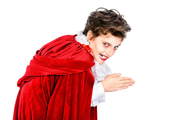Expressive boy in a costume of vampire.