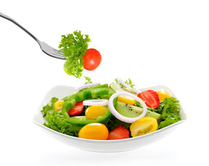 Fruit and vegetable salad in a bowl isolated on white