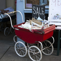 Flea market window shop with old-fashioned goods