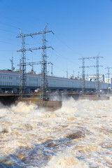 power poles and boiling water in river