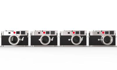 Four compact retro styled digital photo cameras