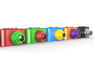 Colorful modern digital cameras with different colored lenses