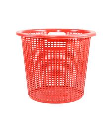 Red plastic basket isolated on white background.