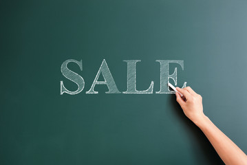 sale written on blackboard
