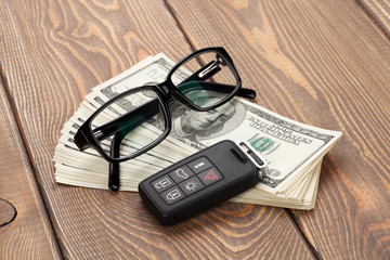 Money cash, glasses and car remote key