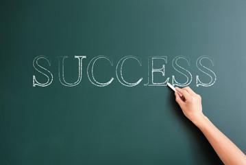 success written on blackboard
