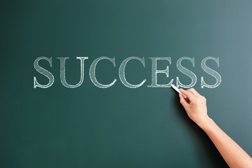 success written on blackboard