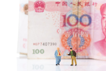 Financial deal concept,businessmen with Chinese money banknotes