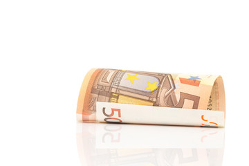 Roll of 50 Euro paper bills isolated on white with clipping path