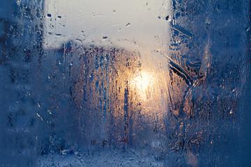 Ice patterns on winter glass.