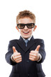 Smiling child boy in business suit wearing sunglasses gesturing