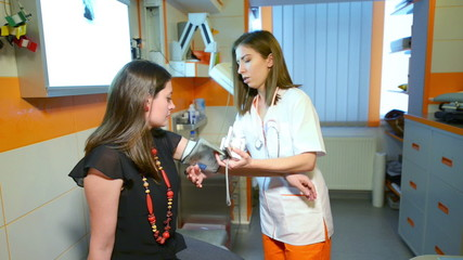 Assistant Doctor measuring blood pressure to a patient