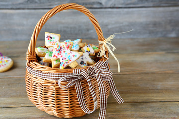 Holiday ginger cookies in a wicker basket on boards