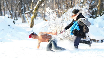Young man half naked falling in the snow