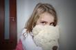 Young sad girl huging a teddy bear - 76348290