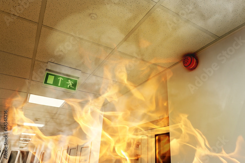 Big fire in the modern office building - 76348216