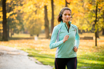 Woman jogging and listening music
