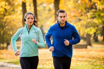 Friends jogging together