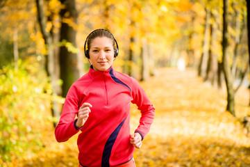 Woman running and listening music